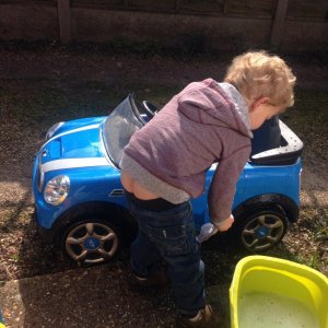 My son cleaning his car to. Good lad